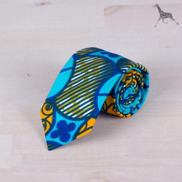 Corbata para niños de tela africana wax con motivos geométricos circulares y tonos turquesa, azul y naranja